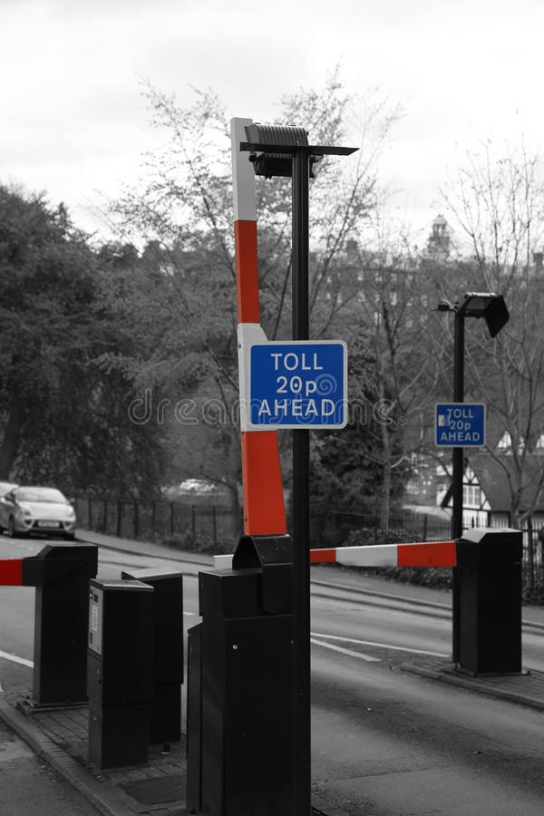 Toll road sign with barrier and price stock photography