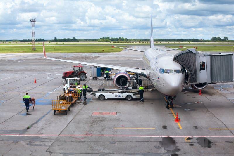Tolmachevo Airport, ground handling services of airplane Boeing 737-800 named after N. Leskov, Aeroflot Airlines. NOVOSIBIRSK, RUSSIA - June 9, 2019: Tolmachevo stock photo
