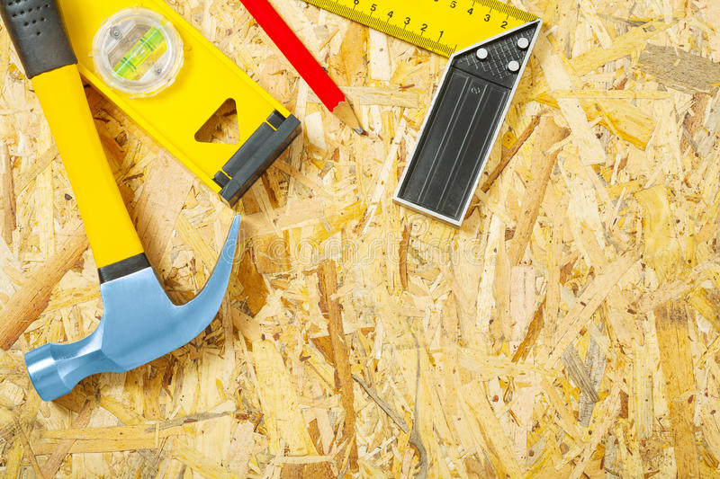 Construction tools on plywood stock photography
