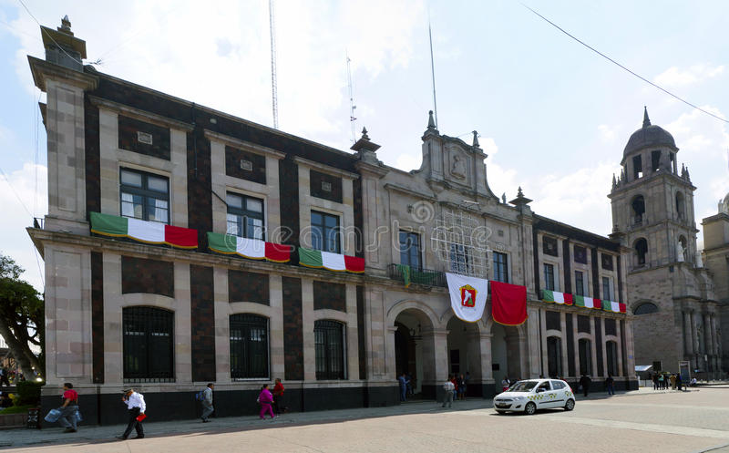 Toluca mexico city hall. The principal building of the city hall in toluca mexico, decorated with some flags in the front face of it in the celebration on royalty free stock image