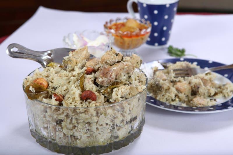 Tolva Biryani, pollo Biryani, briyani de la secuencia del pollo de Idiyappam del pollo de Nool Puttu foto de archivo