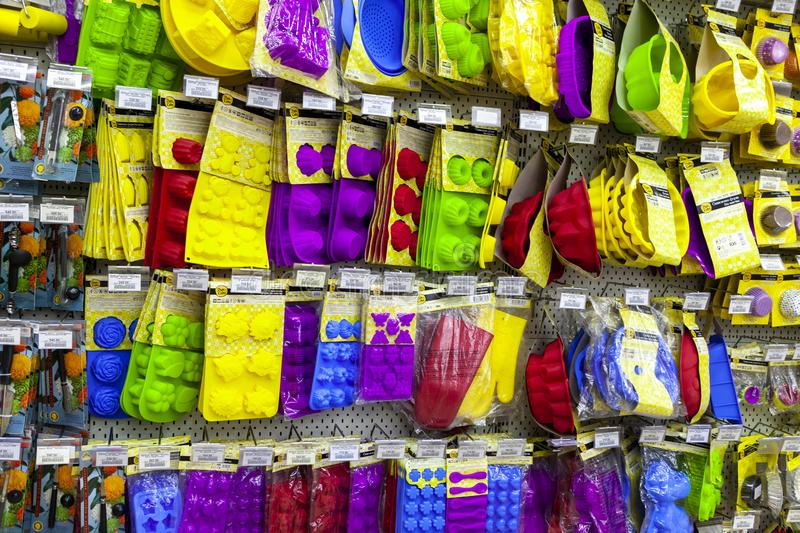 TOLYATTI, RUSSIA, JULY 08, 2018: Store stand with colorful silicone baking equipment. Forms for baking pies, cakes, cookies, cupcackes, making sweets, candies stock image