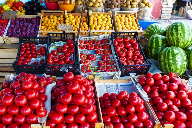 TOLYATTI, RUSSIA, JULY 18, 2018: Street fruit and vegetable store counter with crates. Street fruit and vegetable store counter with crates. Crates of tomato royalty free stock photo