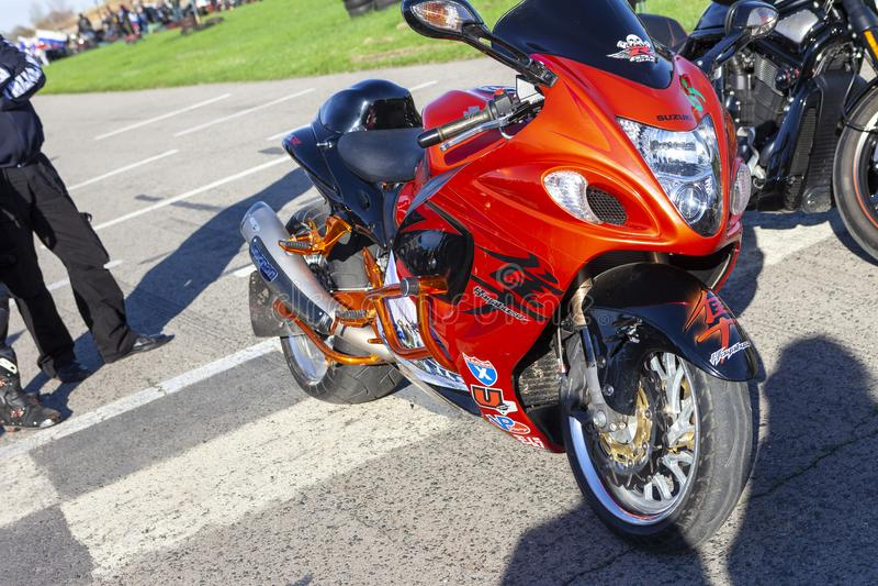 TOLYATTI, RUSSIA, MAY 09, 2018: Biker show dedicated to Victory Day. Orange glossy Suzuki motorbike. Motorcycle with stickers stock photos