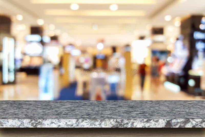 Download Tom överkant Av Den Naturlig Stentabellen Och Suddighet Med Bokehbakgrund Arkivfoto - Bild av detaljhandel, marknad: 76703524
