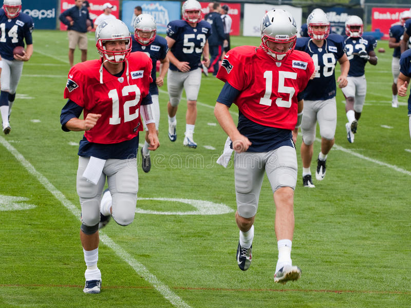 Tom Brady. And Ryan Mallett at training camp in Foxborough MA. August 2013 stock images