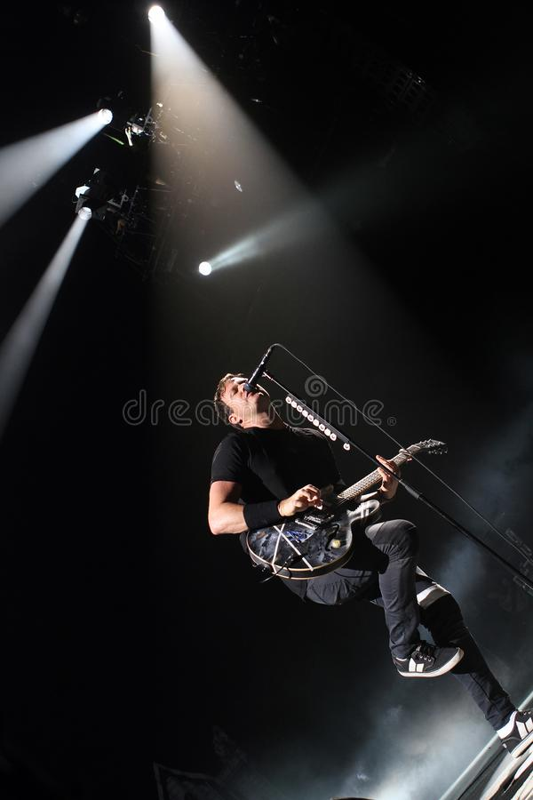 Blink 182 performs in concert. Tom Delonge with Blink 182 performs in concert at the Cruzan Amphitheater in West Palm Beach, Florida on September 23, 2011 stock photo