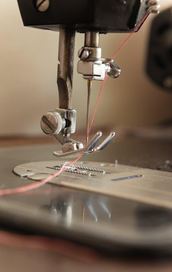 Tom do vintage da agulha da máquina de costura foto de stock royalty free
