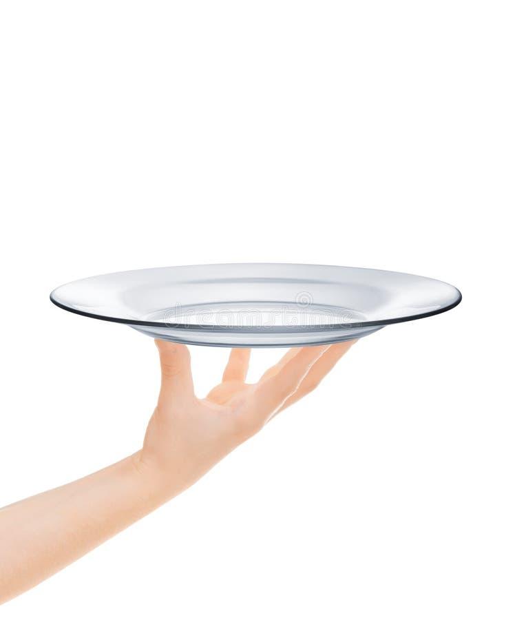 Tom glass platta på den mänskliga handen royaltyfri fotografi