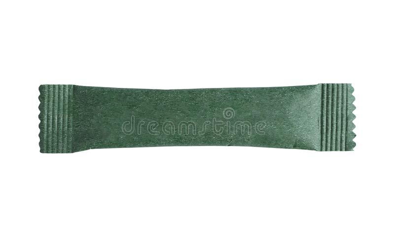 Tom grön pinnepåsepacke som isoleras på vit arkivfoto