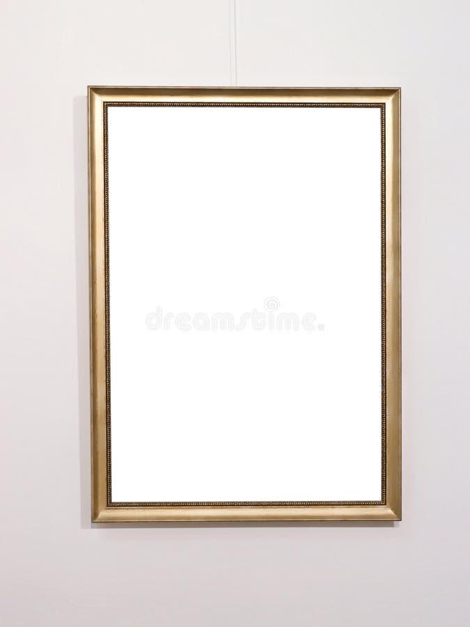Tom guld- bildram på den vita väggen royaltyfri bild