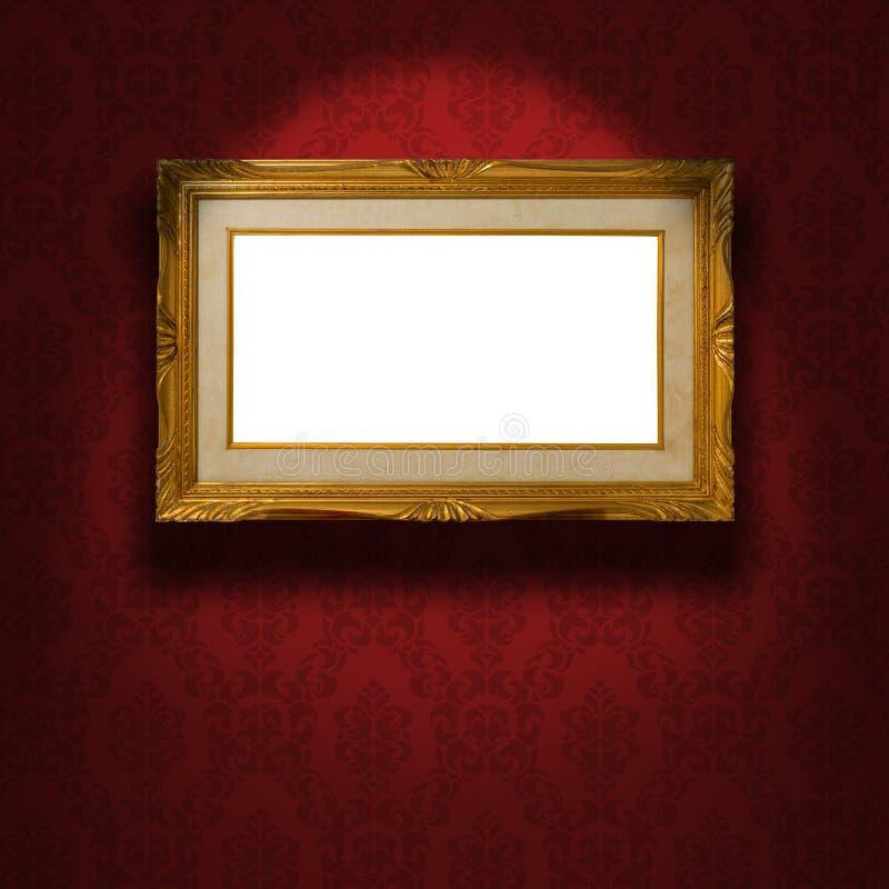 Tom guld- ram på väggen. arkivfoton