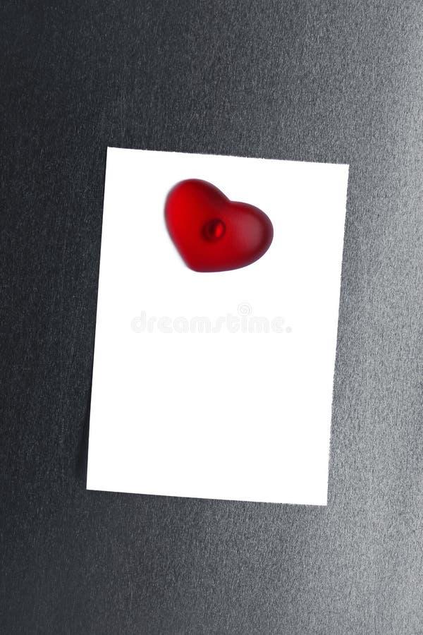 Tom hjärta för magnet för anmärkningskort fäst ihop arkivfoton