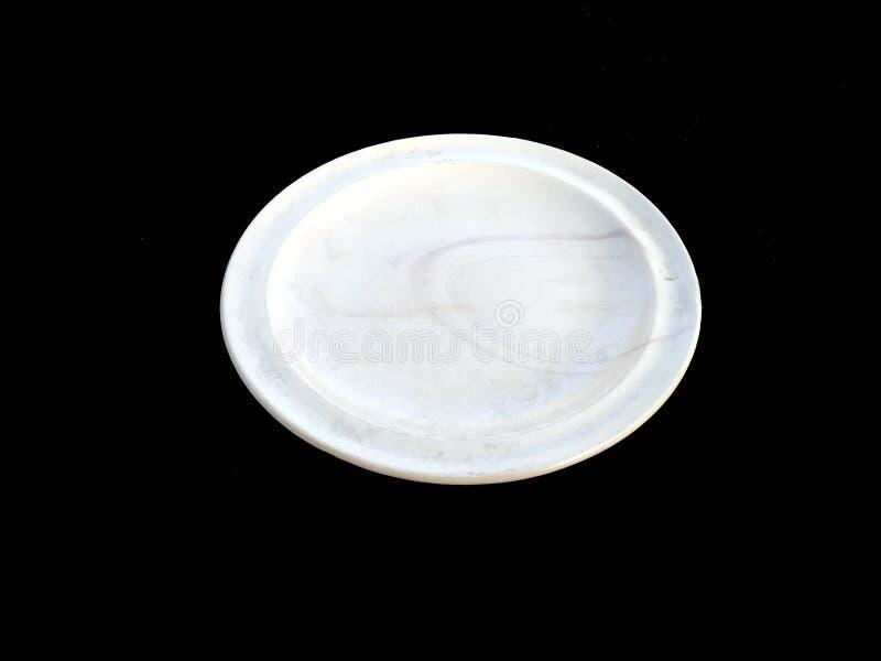 Tom plattaisolat p? vit bakgrund fotografering för bildbyråer