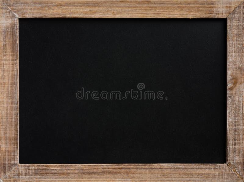 Tom svart tavla för tappning med träramen royaltyfri fotografi