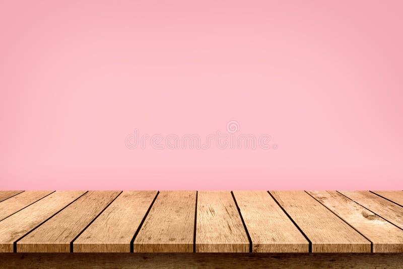 Tom trätabellöverkant på pastellfärgad rosa färgbakgrund som används för skärm eller montage dina produkter royaltyfria foton