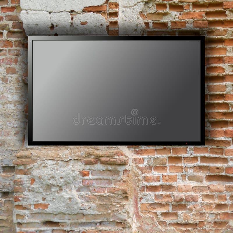 Tom tv på tegelstenväggen royaltyfri bild