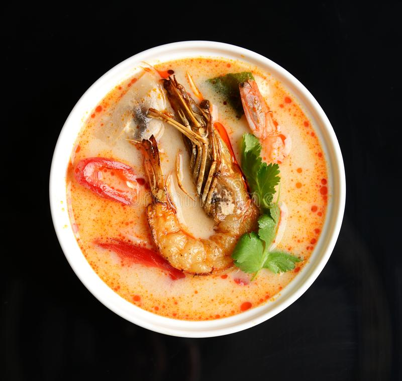 Tom yam kong or Tom yum spicy Thailand Dish Cuisine soup with king prawn chili pepper and mashrooms royalty free stock image