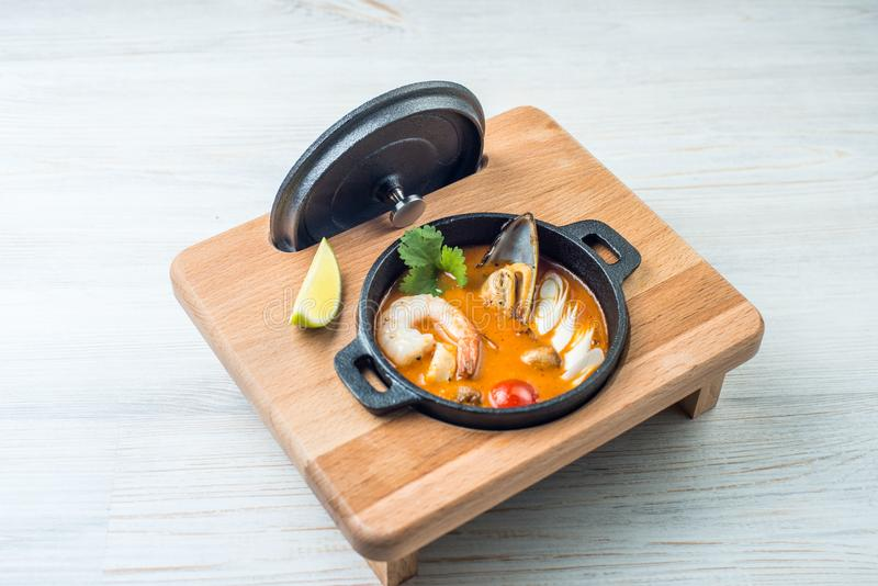 Tom yam kong on wooden table. Thai food royalty free stock photo