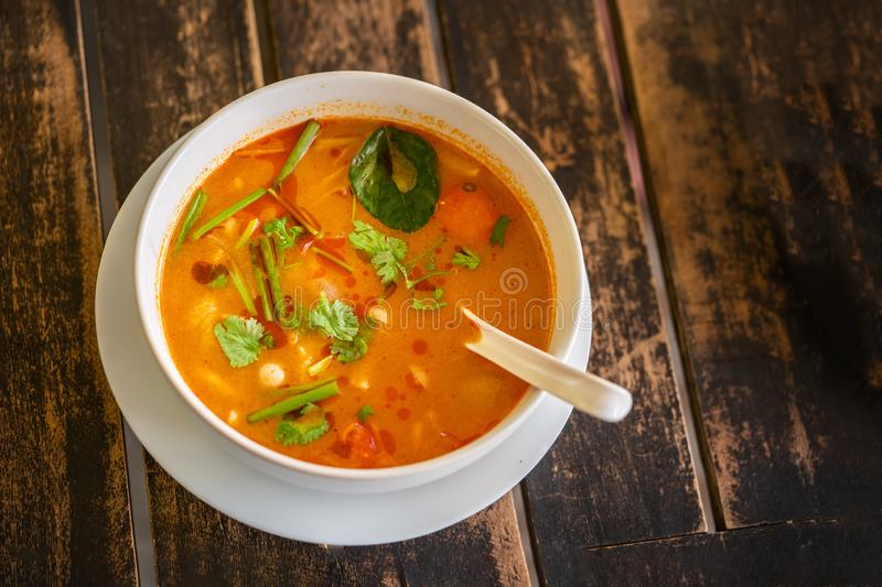 Tom Yam Kung, Thai cuisine. on a wooden table, top view royalty free stock image