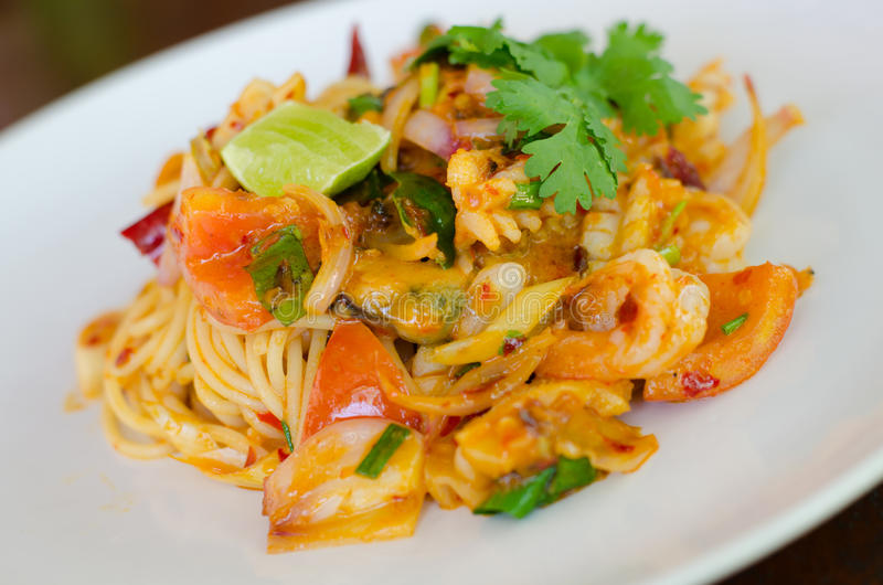 Tom Yum Goong Spaghetti stock photography