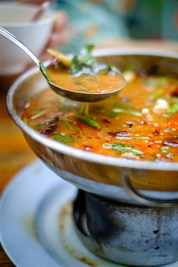 Tom Yum kung a traditional hot and spicy Thai soup with shrimp, coconut milk stock photo