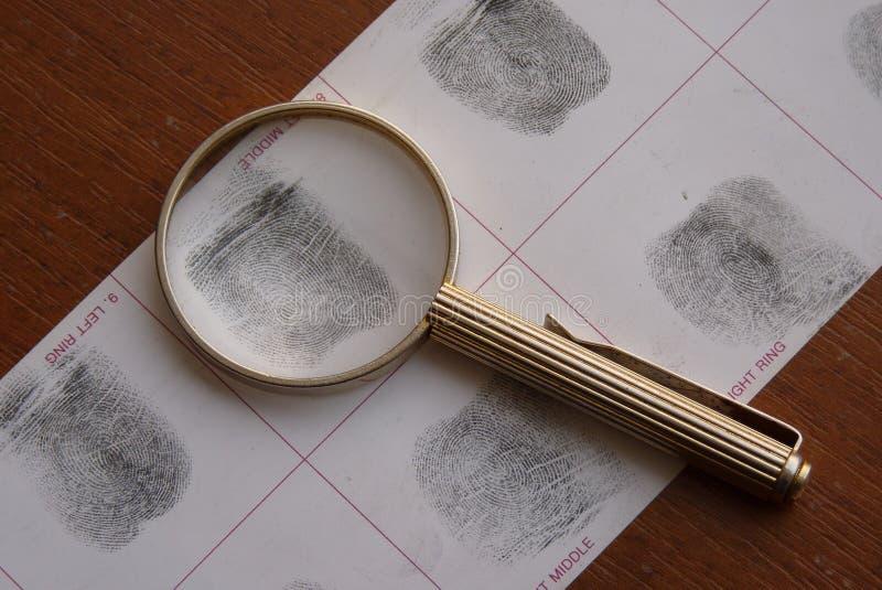 Toma as impressões digitais o exame fotografia de stock
