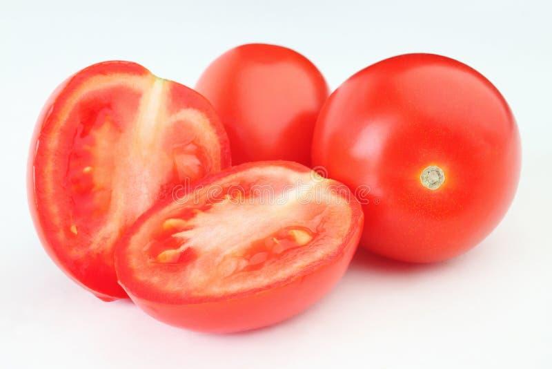 Tomaat. Gesneden groep rode tomaten stock afbeeldingen