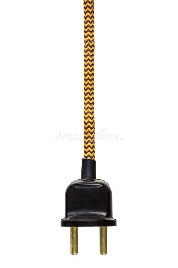 Tomada de poder do vintage com o cabo amarelo isolado no branco fotografia de stock royalty free