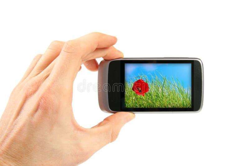 Tomar el cuadro con el teléfono móvil imagenes de archivo
