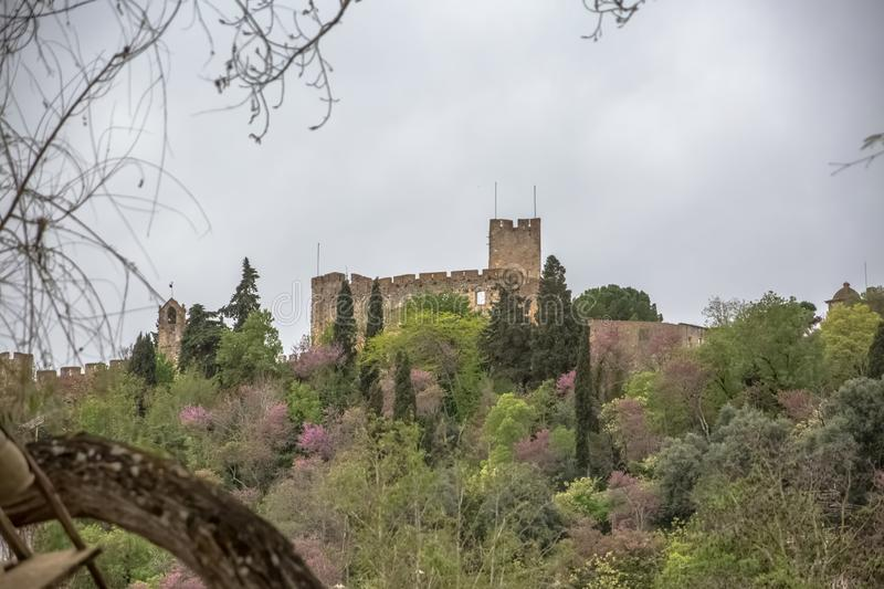 Full View at the Convent of Christ and Tomar city downtown, Roman Catholic convent in Tomar, originally Templar stronghold. Tomar / Portugal - 04 04 2019 : Full royalty free stock image