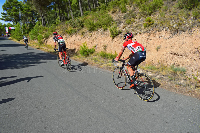 Tomasz marczynski And Rohan Dennis Cycle Racing. The Lotto Soudal and BMC riders follow a distant rider on stage eight Xorret De Cati in the 2017 La Vuelta stock photography