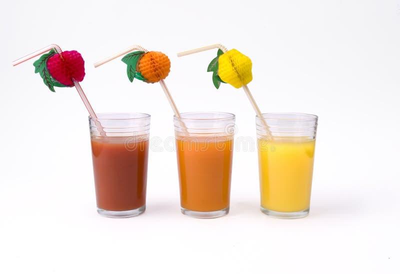 tomat för sugrör för exponeringsglasfruktsaftkiwi orange royaltyfri foto