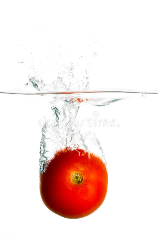 Tomat i vatten arkivfoton