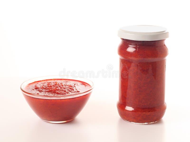 Tomat och cayenne sås royaltyfri fotografi