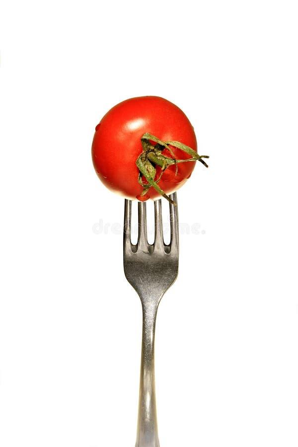 Tomate avec la fourchette images libres de droits