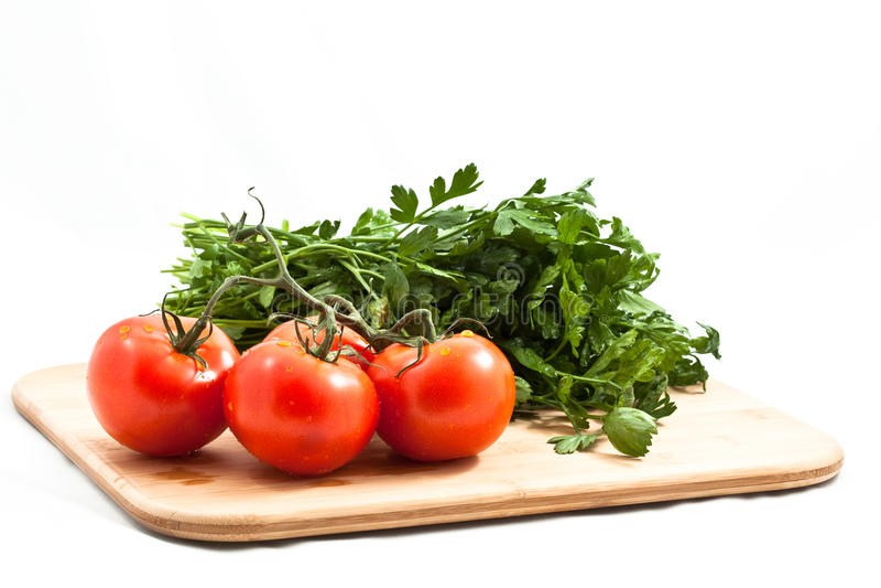Tomate avec parsely photographie stock libre de droits