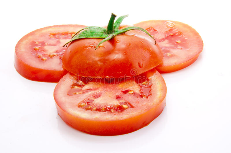 Tomate coupée en tranches images stock