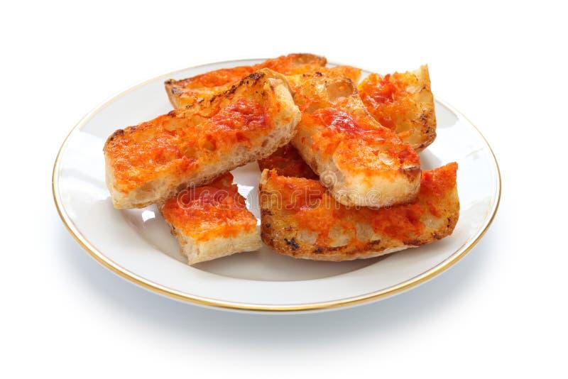Tomate de la estafa de la cacerola, pan español del tomate fotografía de archivo