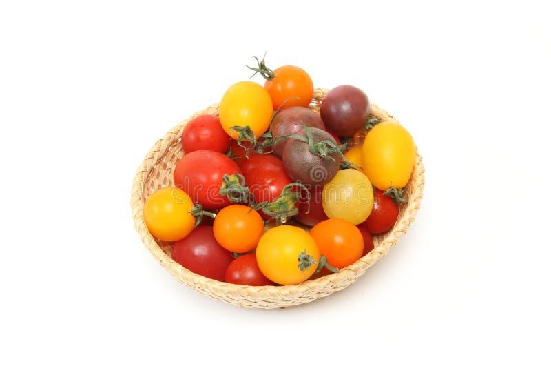 Tomate de la uva en un fondo blanco foto de archivo