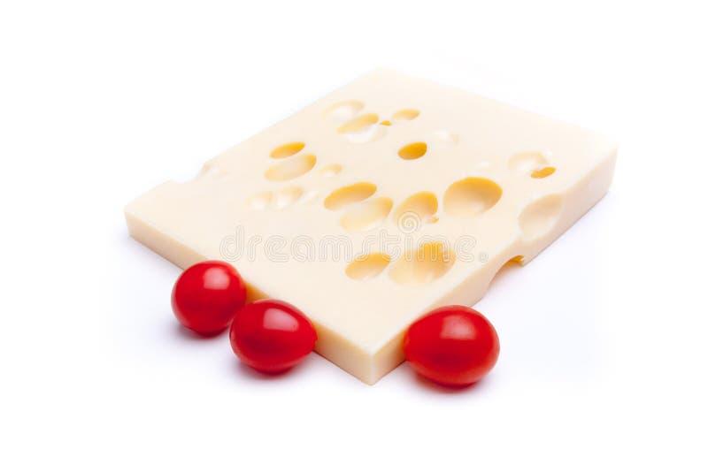 Tomate do queijo suíço n foto de stock