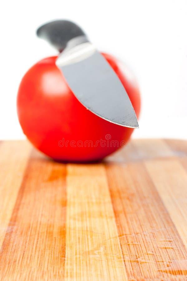 Tomate e faca foto de stock