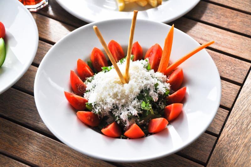 Tomate e salada verde imagens de stock royalty free
