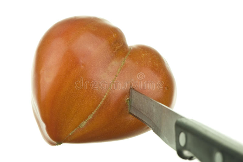 Tomate et couteau photographie stock