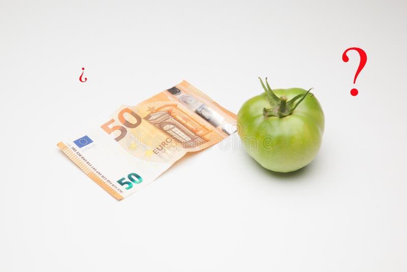 Tomate, fruto e seu preço no mercado imagem de stock