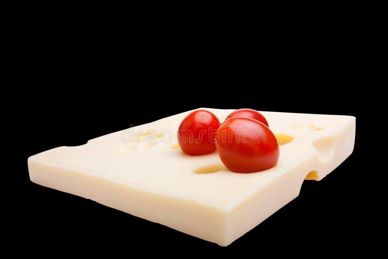 Tomate grampeado do queijo suíço n foto de stock