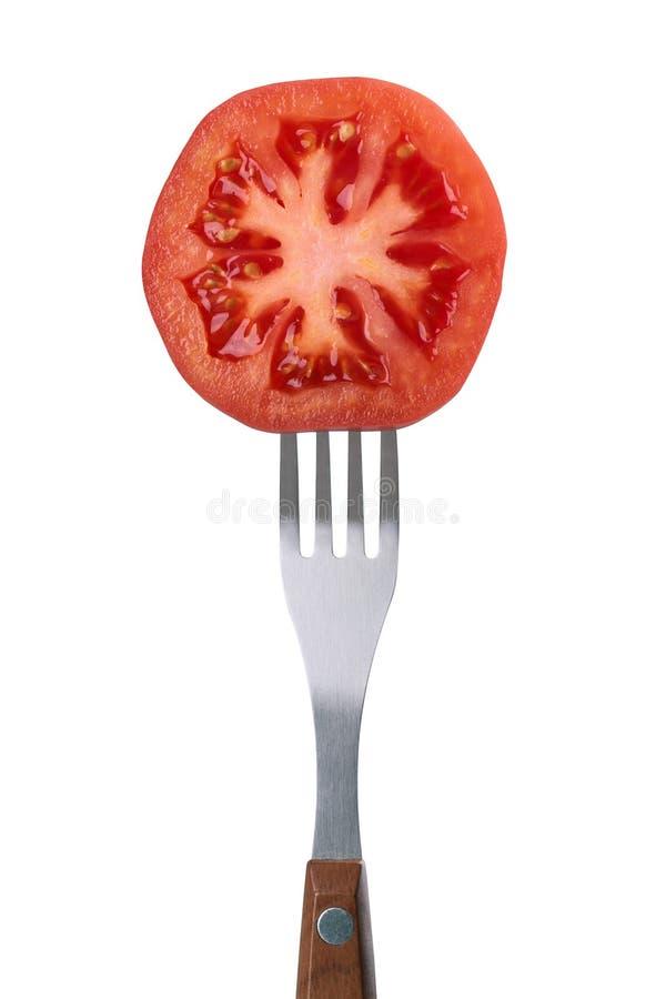Tomate sur une fourchette image stock