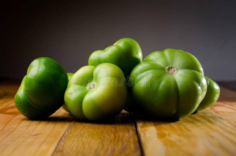 Tomate verde imagenes de archivo