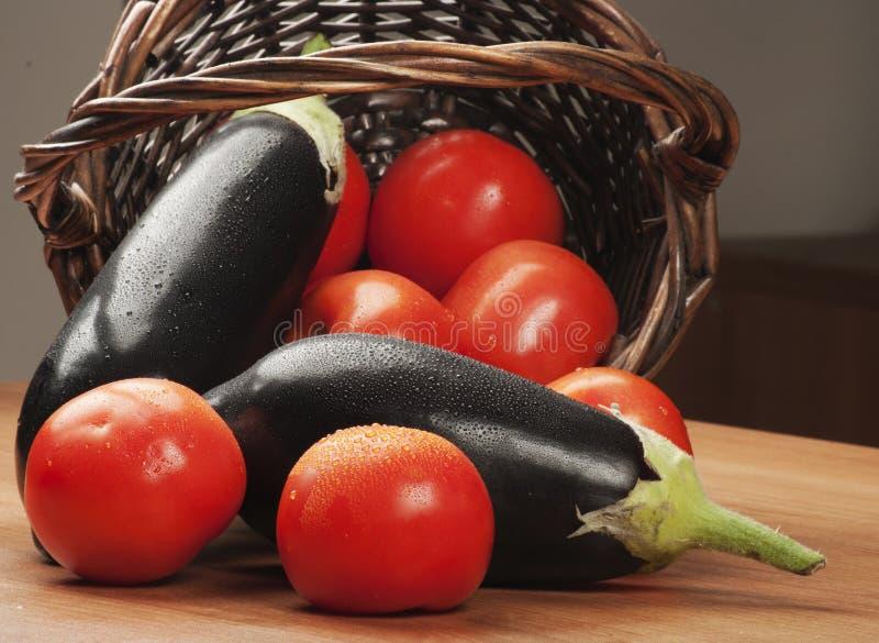 Tomaten en aubergines stock afbeelding