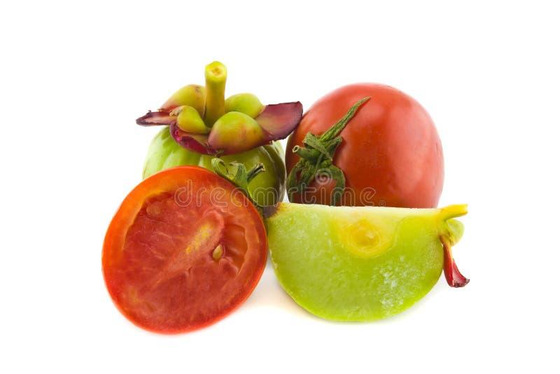 Tomaten en Garcinia stock afbeeldingen
